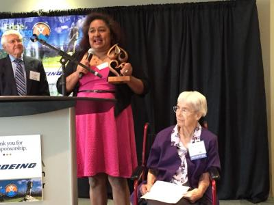 "Sanda Solano-Huber, Program Coordinator for Familias Unidas, accepts the ""ChangeMaker"" Award presented by Sister Georgette Bayless (seated)."