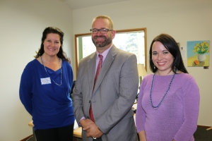 LCSNW staff and CEO present at the event discussed the future of the Arlington Community Resource Center. Left to right are Center Manager Seanna Herring-Jensen, CEO David Duea and Development Director Jaime Schilling.