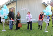 The ribbon cutting ceremony included Bill Tsoukalis (Executive Director of the Boys and Girls Club, Snohomish County), Jo Olson (Executive Director of the Stillaguamish Senior Center), Mayor Barbara Tolbert and LCSNW Family Support Center Director Crisann Brooks.